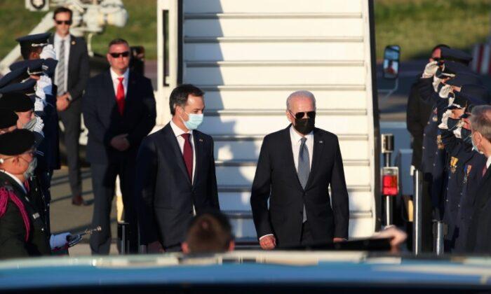 Belgium's Prime Minister Alexander De Croo welcomes U.S. President Joe Biden as he arrives ahead of a NATO summit, at Brussels Military Airport in Melsbroek, Belgium, on June 13, 2021. (Yves Herman/Pool/Reuters)
