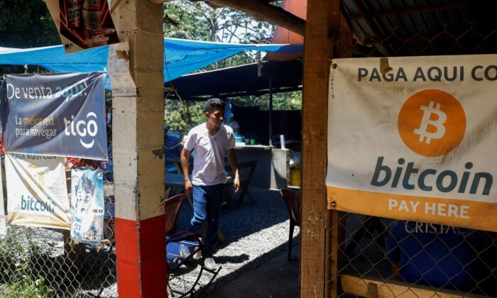 Bitcoin banners are seen outside of a small restaurant at El Zonte Beach in Chiltiupan, El Salvador, on June 8, 2021. (Jose Cabezas/Reuters)