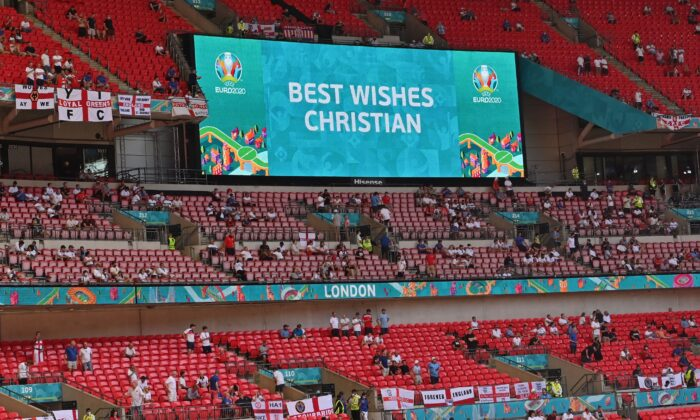 A message in support to Denmark's midfielder Christian Eriksen before the UEFA EURO 2020 Group D football match between England and Croatia at Wembley Stadium in London on June 13, 2021. (Justin Tallis/POOL/AFP via Getty Images)