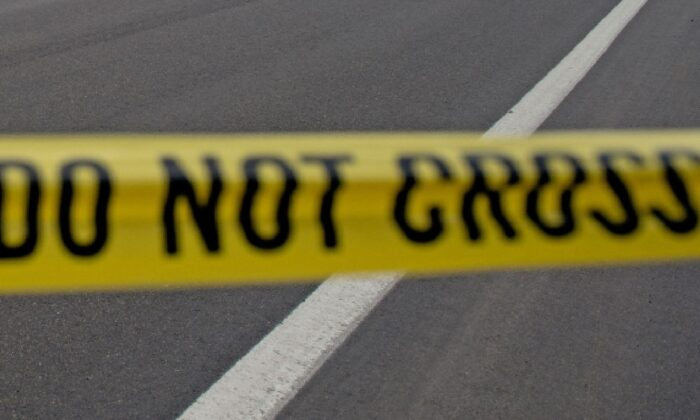 Police tape is seen in a file photo. (Jason Connolly/AFP via Getty Images)