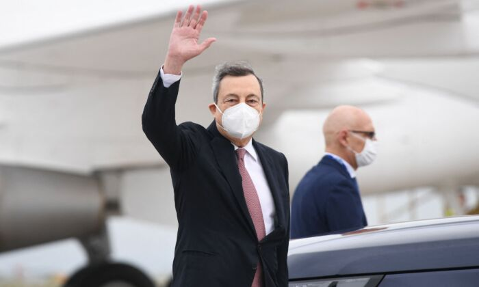 Italy's Prime minister Mario Draghi arrives at Cornwall Airport Newquay, near Newquay, Cornwall, for the G7 summit, on June 11, 2021. (STEFAN ROUSSEAU/POOL/AFP via Getty Images)