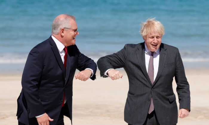 Britain's Prime Minister Boris Johnson greets Australia's Prime Minister Scott Morrison at the G7 summit in Carbis Bay on June 12, 2021 in Carbis Bay, Cornwall. (Adrian Dennis-WPA Pool/Getty Images)