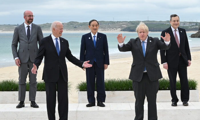 (L-R) President of the European Council Charles Michel, U.S. President Joe Biden, Japanese PM Yoshihide Suga, British PM Boris Johnson, and Italian PM Mario Draghi pose for the Leaders official welcome and family photo during the G-7 Summit in Carbis Bay, Cornwall, on June 11, 2021. (Leon Neal/WPA Pool/Getty Images)