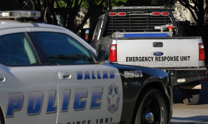 A Dallas police car and an emergency response vehicle sit in a parking lot in Dallas, Texas, in this file photo taken on Oct. 16, 2014. (Mike Stone/Getty Images)