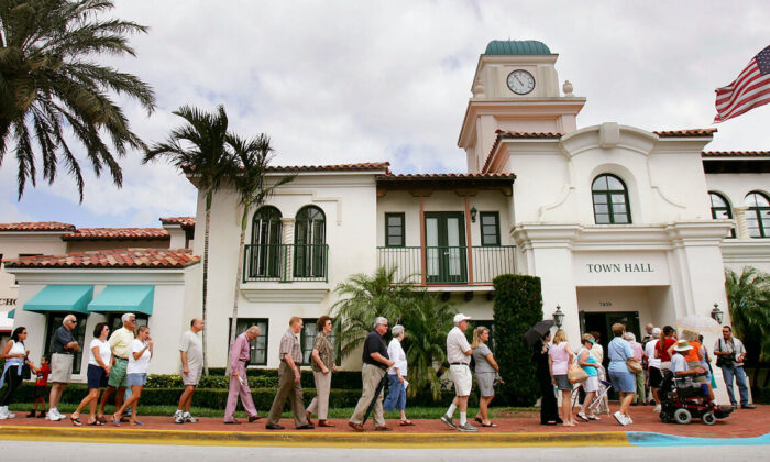Voters wait to cast their ballots outside a polling place in Palm Beach County in West Palm Beach, Fla., on Nov. 2, 2004. (Mario Tama/Getty Images)