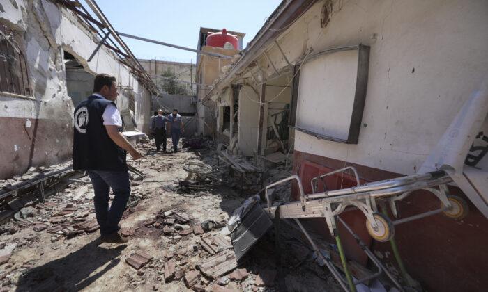 A man walks through a heavily damaged hospital in the city of Afrin, Syria, on June 13, 2021. (Ghaith Alsayed/AP Photo)