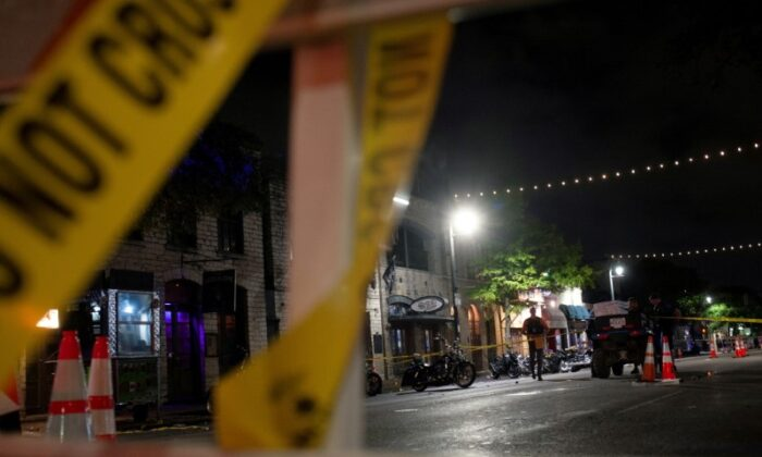Police investigate the scene of a mass shooting in the Sixth Street entertainment district area of Austin, Texas, on June 12, 2021. (Nuri Vallbona/Reuters)