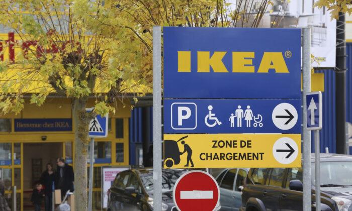 Customers leave an IKEA store in Plaisir, west of Paris, on Nov. 30, 2013. (Remy de la Mauviniere/AP Photo)