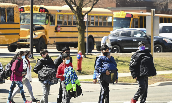 Students cross the street  during the COVID-19 in a file photo. (The Canadian Press/Nathan Denette)