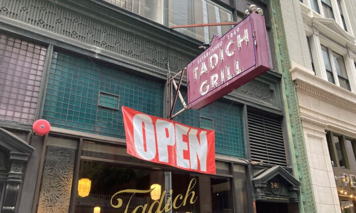 An open banner hangs outside the Tadich Grill, California's oldest restaurant, in San Francisco on June 4, 2021. (Eric Risberg/AP Photo)