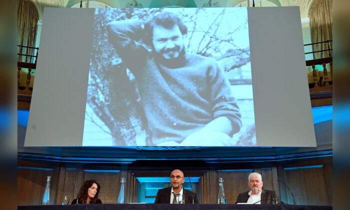 Alastair Morgan (R), the brother of murdered private investigator Daniel Morgan, with his partner Kirsteen Knight and family solicitor Raju Bhatt (C) speaking to the media following the publication of the Daniel Morgan Independent Panel report, at Church House, in Westminster, central London on June 15, 2021. (Kirsty O'Connor/PA)