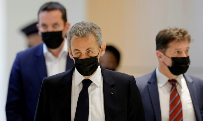 Former French President Nicolas Sarkozy arrives for a hearing in a trial over alleged illegal financing of his failed reelection campaign in 2012, with 13 other defendants, former officials of Bygmalion and representatives of the UMP, at the courthouse in Paris, France, on June 15, 2021. (Pascal Rossignol/Reuters)