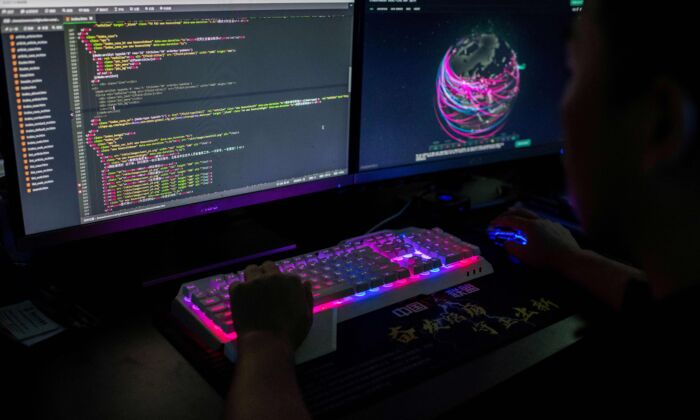 A man uses a computer in an Internet cafe in Beijing on June 1, 2017. (Greg Baker/AFP via Getty Images)