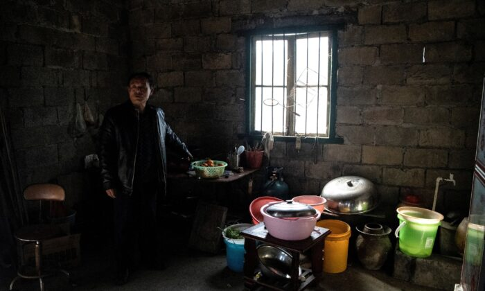 Farmer Liu Qingyou at his residence in Baojing County, in central China's Hunan Province on Jan. 12, 2021. (Noel Celis/AFP via Getty Images)