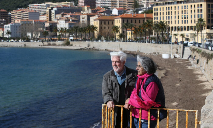 If you're living in retirement, it can be helpful to monitor inflation rates and meet with a financial adviser periodically to review your financial situation. (PASCAL POCHARD-CASABIANCA/AFP via Getty Images)