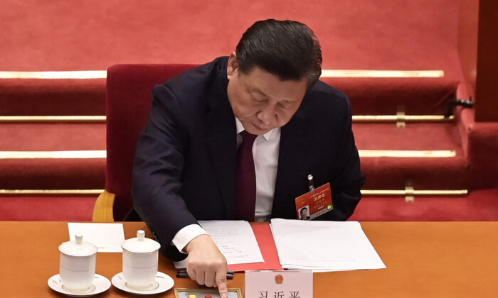 Chinese leader Xi Jinping votes on changes to Hong Kong's election system during the closing session of China's rubber-stamp legislature, the National People's Congress, at the Great Hall of the People in Beijing, China on March 11, 2021. (Nicolas Asfouri/AFP via Getty Images)