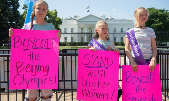Young demonstrators with the group Stanton Public Policy Center's Purple Sash Revolution hold a rally in support of Uyghur women and call to boycott the 2022 Olympic Games in Beijing during a protest at Lafayette Park outside the White House in Washington, on May 27, 2021. (Saul Loeb/AFP via Getty Images)