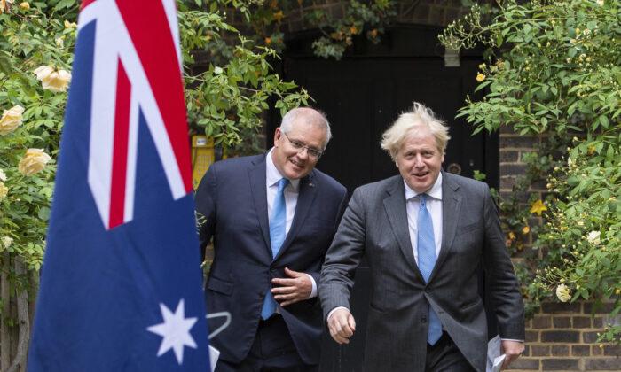 Britain's Prime Minister Boris Johnson (R) walks with Australian Prime Minister Scott Morrison after their meeting, in the garden of 10 Downing Street, in London, on June 15, 2021. (Dominic Lipinski/Pool via AP)