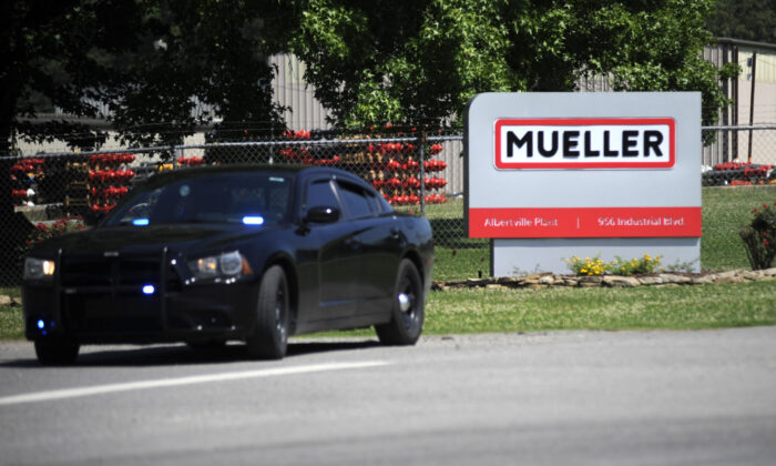 A police car guards the entrance to a Mueller Co. fire hydrant plant where police said multiple people were shot to death and others were wounded in Albertville, Ala., on June 15, 2021. (Jay Reeves/AP Photo)