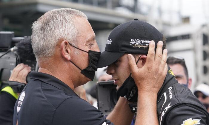 Marijn van Kalmthout talks with is son, Rinus VeeKay, at Indianapolis Motor Speedway in Indianapolis, Sunday, May 23, 2021. (Darron Cummings/AP Photo)