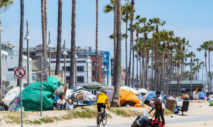 Homeless individuals in Venice Beach, Calif., on June 8, 2021. (John Fredricks/The Epoch Times)