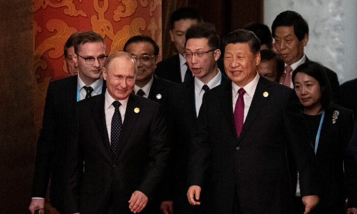 Russia's President Vladimir Putin (front L) and China's President Xi Jinping (C) arrive for the welcome banquet for leaders attending the Belt and Road Forum at the Great Hall of the People in Beijing, China, on April 26, 2019. (Nicolas Asfouri/Pool/Getty Images)