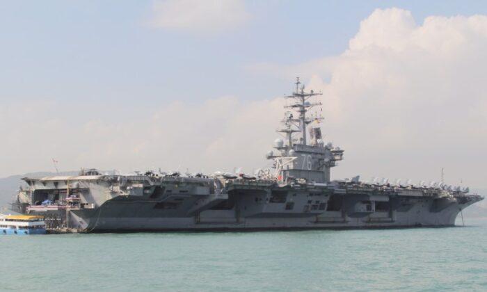 U.S. Navy aircraft carrier USS Ronald Reagan is seen during its visit to Hong Kong, China, on Nov. 21, 2018. (Yuyang Wang/Reuters)