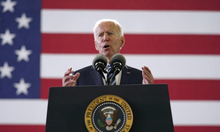 President Joe Biden speaks to American service members at RAF Mildenhall in Suffolk, England, on June 9, 2021. (Patrick Semansky/AP Photo)