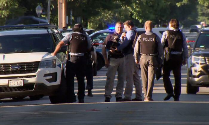 Police at the scene of a shooting in the Englewood neighborhood in Chicago, Ill., on June 15, 2021. (Courtesy of WLS)