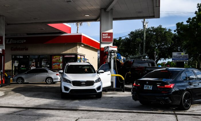 Cars line up to buy gasoline at a gas station in Miami, Fla., on May 12, 2021. (Chandan Khanna/AFP via Getty Images)