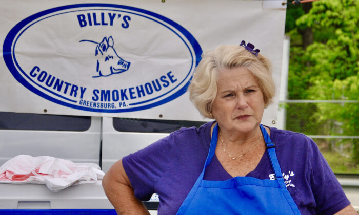 Shirley Stana, owner of Billy's Country Smokehouse, speaks to customers at a Westmoreland County farmers market. (Shannon Venditti)