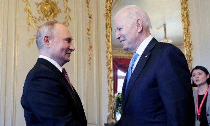 President Joe Biden and Russian President Vladimir Putin shake hands during their meeting in Geneva, Switzerland, on June 16, 2021. (Mikhail Metzel/Pool Photo via AP)