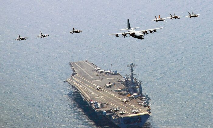Dong Feng D21 Threat: A U.S. Marine Corps C-130 Hercules aircraft leads a formation of F/A-18C Hornet strike fighters and A/V-8B Harrier jets over the aircraft carrier USS George Washington off the coast of South Korea on July 27, 2010. (Mass Communication Specialist 3rd Class Charles Oki/U.S. Navy via Getty Images)