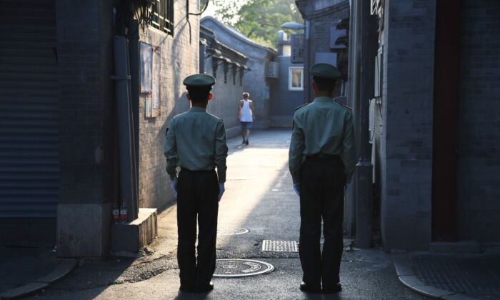 Chinese paramilitary police guard an alley in a street next to Tiananmen Square ahead of an overnight rehearsal of a military parade to mark communist China's 70th anniversary, in Beijing on Sept. 7, 2019. (Greg Baker/AFP via Getty Images)