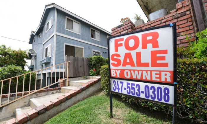 """A """"For Sale by Owner"""" sign is posted in front of property in Monterey Park, Calif., on April 29, 2020. (Photo by FREDERIC J. BROWN/AFP via Getty Images)"""