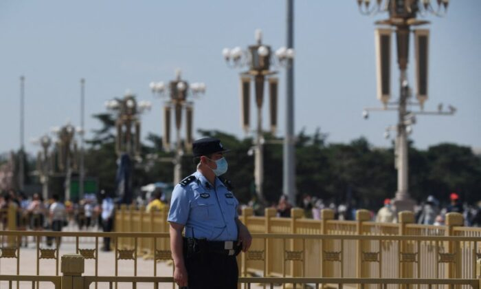 A police officer keeps watch in Tiananmen Square in Beijing on the 32nd anniversary of the deadly 1989 crackdown on pro-democracy protests, on June 4, 2021. (GREG BAKER/AFP via Getty Images)
