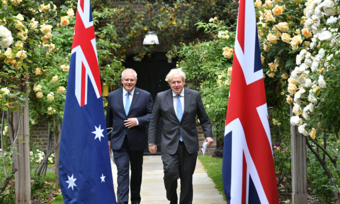 Britain's Prime Minister Boris Johnson (R) and Australia's Prime Minister Scott Morrison arrive to give a statement in the garden of 10 Downing street in central London on June 15, 2021. (Dominic Lipinski/POOL/AFP via Getty Images)