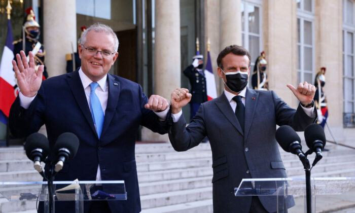 French President Emmanuel Macron (R) and Australia's Prime Minister Scott Morrison answer the press prior to a working diner at the Elysee Palace in Paris on June 15, 2021. (Thomas Samson/AFP via Getty Images)