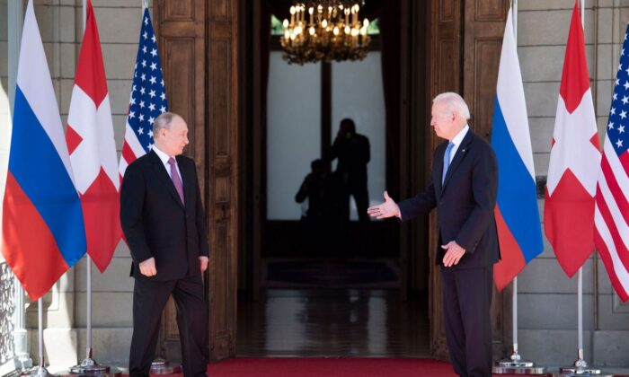 President Joe Biden prepares to shake hands with Russian President Vladimir Putin prior to the U.S.–Russia summit at the Villa La Grange, in Geneva, Switzerland, on June 16, 2021. (Brendan Smialowski/AFP)