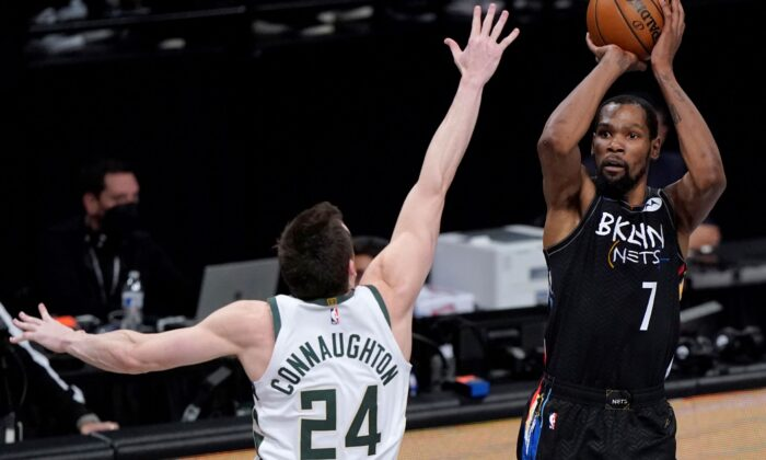 Brooklyn Nets forward Kevin Durant (7) shoots as Milwaukee Bucks guard Pat Connaughton (24) defends during the fourth quarter of Game 5 of a second-round NBA basketball playoff series in New York, on June 15, 2021. (Kathy Willens/AP Photo)