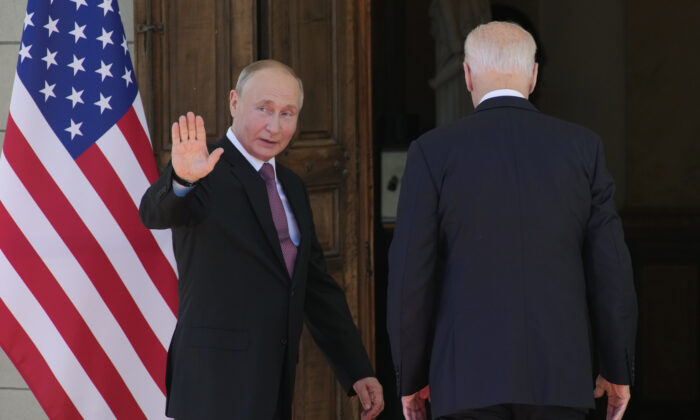 Russian President Vladimir Putin (L) and U.S President Joe Biden (R) enter the 'Villa la Grange' in Geneva, Switzerland on June 16, 2021. (Alexander Zemlianichenko/AP Photo)