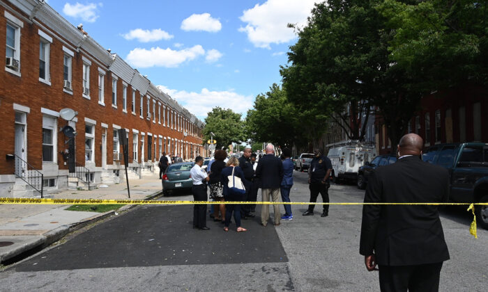 Police investigate a shooting scene with multiple victims in Baltimore's Penrose neighborhood on June 16, 2021. (Kim Hairston/Baltimore Sun/TNS)
