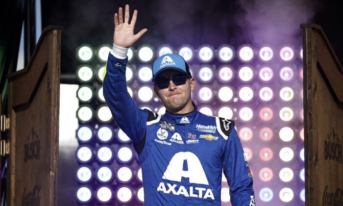 William Byron, driver of the #24 Axalta Chevrolet, waves on stage during driver intros prior to the NASCAR All-Star Race at Texas Motor Speedway in Fort Worth, Texas, on June 13, 2021. (Chris Graythen/Getty Images)