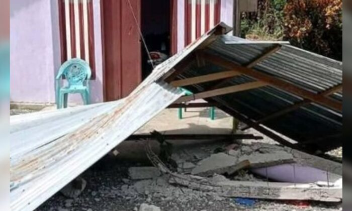 A roof lies on the ground after an earthquake, in Sakanusa, Maluku, Indonesia, on June 16, 2021. (Asmiathy/Reuters)