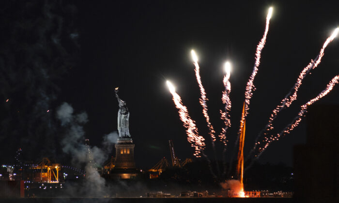 Fireworks explode over New York Harbor and the Statue of Liberty as New York state marks the end of the COVID-19 restrictions and honor frontline workers, in New York City on June 15, 2021.(Craig Ruttle/AP Photo)