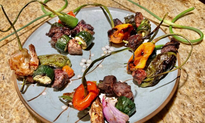 Turn garlic scapes into edible kebab skewers for grilled meat and veggies. (Ari LeVaux)