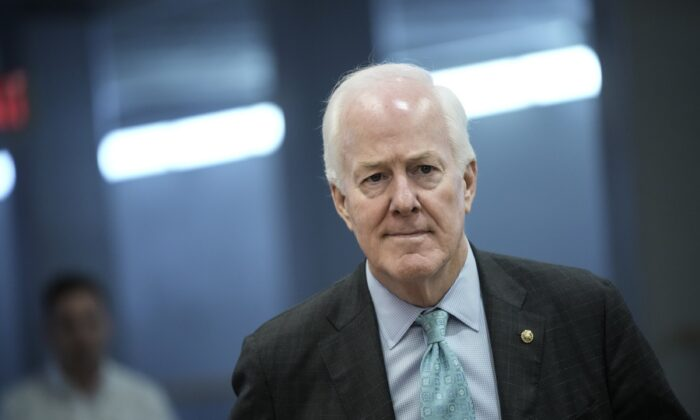 Sen. John Cornyn (R-Texas) walks through the Senate subway on his way to a vote at the U.S. Capitol in Washington on May 27, 2021. (Drew Angerer/Getty Images)