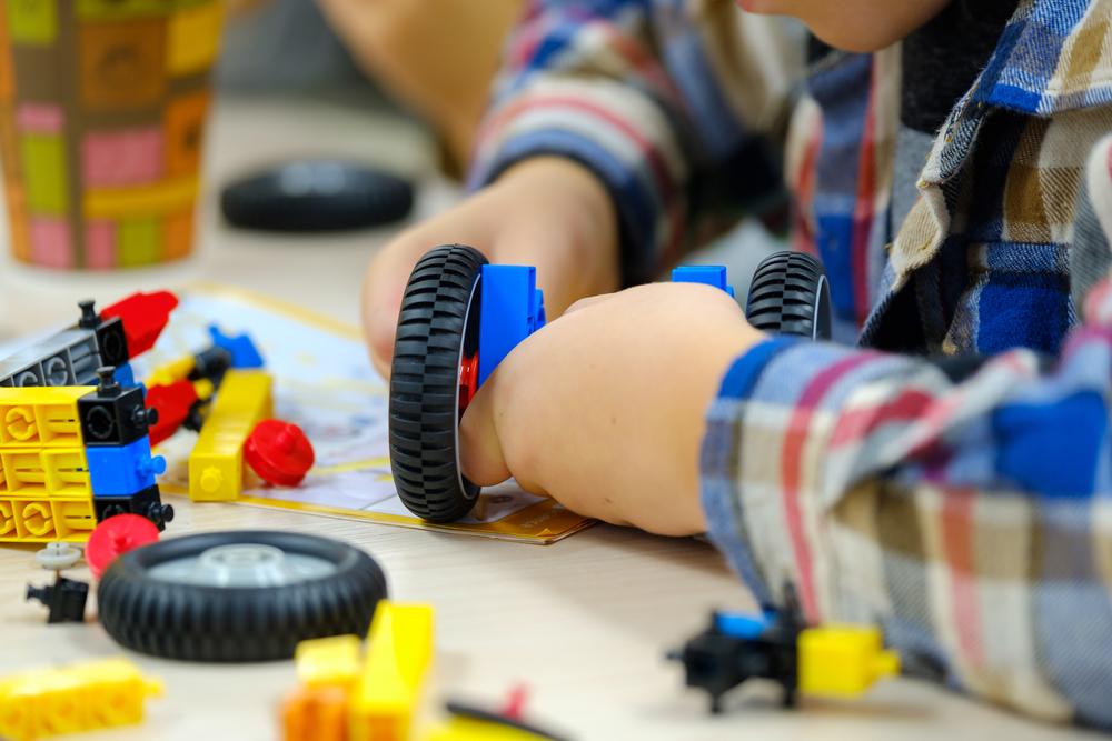 Child,Plays,With,A,Children's,Designer