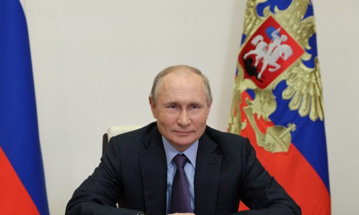 Russian President Vladimir Putin takes part in a ceremony launching the Amur gas processing plant managed by Gazprom company via video link outside Moscow, Russia, on June 9, 2021. (Sputnik/Sergei Ilyin/Kremlin via Reuters)