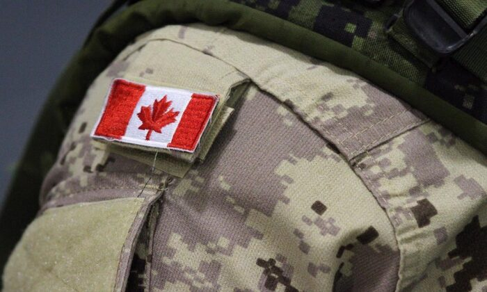 """A Canadian flag patch is shown on a soldier's shoulder in Trenton, Ont., on Oct. 16, 2014. Police in North Vancouver say Canadian Armed Forces personnel were called to assess a historical ordinance a person bought believing it was an """"interesting artifact."""" ( The Canadian Press/Lars Hagberg)"""